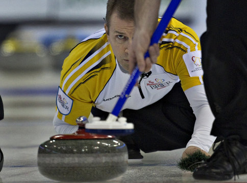 Manitoba skip Stoughton keeps his eye on the line of his shot during their page playoff game at the Canadian Men's Curling Championships in Edmonton
