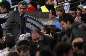 Real Madrid's coach Jose Mourinho looks around as he leaves his seat in the stands just before the end of their Spanish first division soccer match against Athletic Bilbao in Madrid