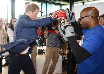 Britain's Prince Harry boxes during a Heads Together mental health campaign launch in Stratford, East London