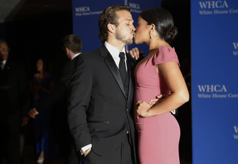 Actors Rodriguez and Esteve kiss as they arrive for the annual White House Correspondents' Association dinner in Washington