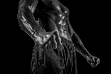 Part of a man's body on a dark background with copyspace