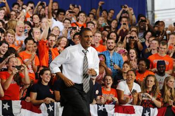 U.S. President Barack Obama walks out to speak at Charlottesville nTelos Wireless Pavillion in Virginia