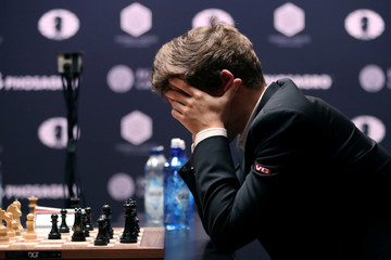 Current World Chess Champion Carlsen of Norway reacts to a move from Karjakin of Russia during the first game of their rapid chess tie-breaker match at the 2016 World Chess Championship match in New York