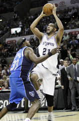 Duncan shoots over Haywood during the second half of Game 3 of their NBA Western Conference quarter-final playoff basketball game in San Antonio