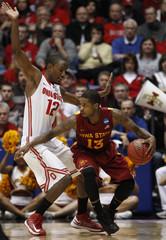 Ohio State Buckeyes forward Thompson guards Iowa State Cyclones guard Lucious during their third round NCAA tournament basketball game in Dayton