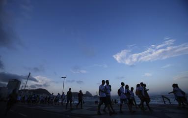 Pilgrims walk at Copacabana beach ahead of Pope Francis' visit to Rio de Janeiro