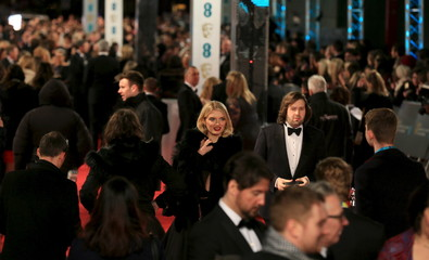 Guests arrive at the British Academy of Film and Television Arts (BAFTA) Awards at the Royal Opera House in London