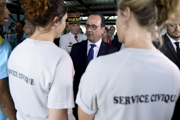 "France's President Francois Hollande talks with members of the civic service at the 2nd RSMA - ""Regiment du service militaire adapte"" in Pointe-a-Pitre"