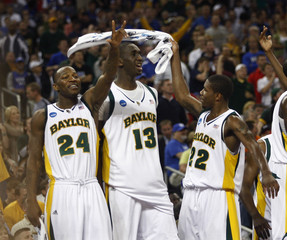 Baylor's Dunn, Udoh and Walton  celebrate their victory against St. Mary's in their NCAA South Regional college basketball game in Houston
