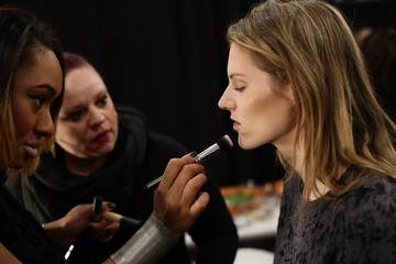 A model has her make-up done before the Timo Weiland Autumn/Winter 2013 collection runway show during New York Fashion Week, in New York