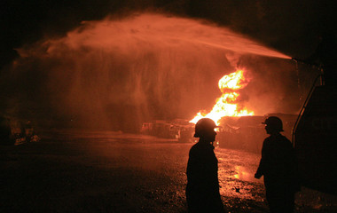 Fire-fighters attempt to douse burning fuel tankers which were set ablaze in the outskirts of Peshawar in northwest Pakistan