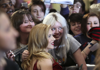 """Scarlett Johansson takes pictures with fans as she arrives at the UK premiere of """"Captain America: The Winter Soldier"""" at Shepherds Bush in London"""