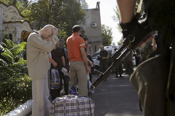 Ukrainian war prisoners are guarded by servicemen of the separatist self-proclaimed Donetsk People's Republic army in Donetsk