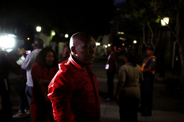 Leader of the Economic Freedom Fighters Julius Malema reacts after he was removed by security forces from President Zuma's State of the Nation Address in Cape Town