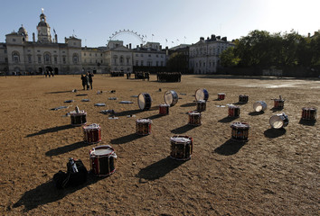 Drums and other instruments mark positions of a marching band before a Trafalgar Day parade in London