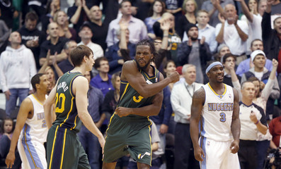 Utah Jazz Carroll celebrates with teammate Hayward during their NBA game against Denver Nuggets in Salt Lake City