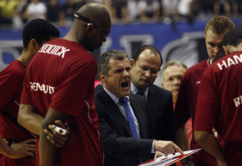 Giovanni Bozzi, the head coach Belgacom Spirou, instructs players during their Euroleague Group C basketball game against Partizan Belgrade in Belgrade