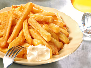 French fries, mayo and glass of beer.