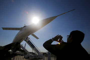 Visitor takes picture of Tupolev Tu-144 commercial supersonic transport aircraft on display at MAKS International Aviation and Space Salon in Zhukovsky