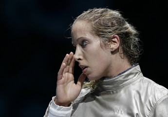 Mariel Zagunis of the U.S. reacts during their women's sabre individual semifinals fencing competition against South Korea's Jiyeon Kim at the London 2012 Olympic Games