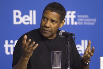 """Actor Denzel Washington attends a news conference to promote the film """"The Equalizer"""" at the Toronto International Film Festival (TIFF) in Toronto"""