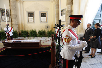 Labour Party leader Muscat and his wife view the body of Malta's former Prime Minister and Labour Party leader Mintoff lying in state at the Presidential Palace in Valletta