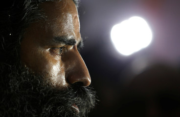Indian yoga guru Baba Ramdev talks to media after a news conference in New Delhi