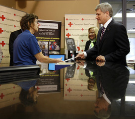 Canada's PM Harper makes a donation to the Canadian Red Cross with his wife in Ottawa