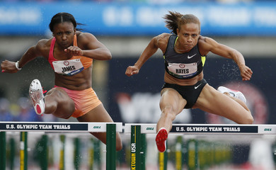 Hurdlers Joanna Hayes and Pavi'Elle James compete in the women's 100 meters hurdles qualifying at the U.S. Olympic athletics trials in Eugene, Oregon