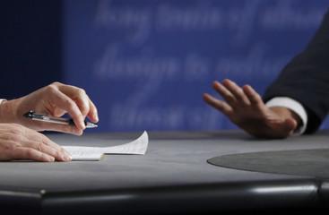 The hands of Democratic U.S. vice presidential nominee Senator Tim Kaine and Republican U.S. vice presidential nominee Governor Mike Pence are seen during their vice presidential debate at Longwood University in Farmville