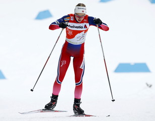 Oestberg, wearing the leader's red jersey,  competes during the women's FIS Tour de ski cross-country skiing 5km individual free race in Toblach