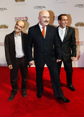 Syrian actors Salloum Haddad, Mohanad Kotesh and filmmaker Nidal Aldibs arrive for the opening ceremony of the Abu Dhabi Film Festival at Emirates Palace