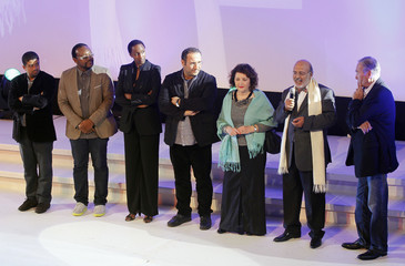 Jury president for the Feature Film category of the 24th Carthage Film Festival Ali Louati speaks on stage during the Festival's opening ceremony in Tunis
