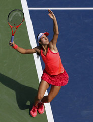 Christina McHale of the U.S. serves to Marion Bartoli of France during their match at the U.S. Open tennis tournament in New York