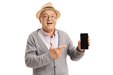Mature man holding a phone and pointing