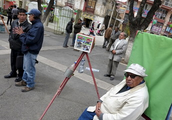 A photographer with a old camera is seen at Churubamba square in La Paz, Bolivia