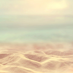 Vintage Sand beach tropical with blurred sea sky and sunny background, summer day, copy space.
