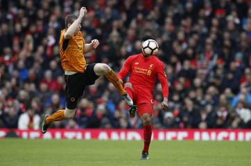 Wolverhampton Wanderers' Jon Dadi Bodvarsson in action with Liverpool's Joe Gomez