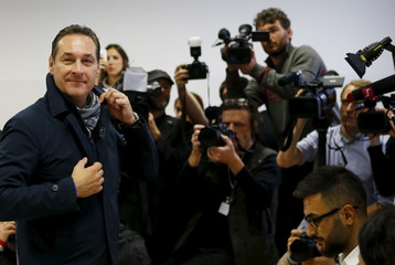 Strache arrives at a polling station during regional elections in Vienna