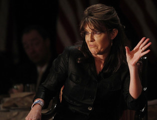 Former Alaska governor Sarah Palin gestures as she speaks during the LIA Annual Meeting & Luncheon in Woodbury, New York