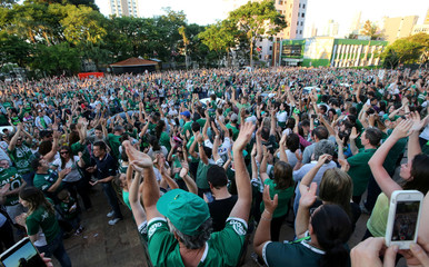 Fans of Chapecoense soccer team gather in the streets to pay tribute to their players in Chapeco