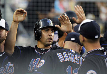 New York Mets' Beltran is congratulated for scoring against Los Angeles Dodgers during their MLB baseball game in Los Angeles