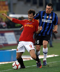AS Roma's Vucinic is challenged by Lucio of Inter Milan during their Italian Serie A soccer match at the Olympic Stadium in Rome