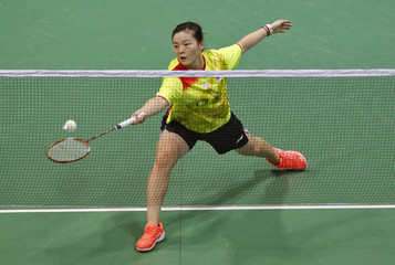 Singapore's Fu Mingtian returns a shot to Australia's Joy Lai during their women's singles match in the Uber Cup badminton championship in New Delhi