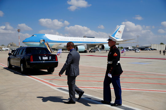 A member of the American navy honor guard walks on the tarmac as Air Force One is seen in the background waiting for U.S. President Donald Trump and first lady Melania to depart en route to Rome, at Ben Gurion International Airport in Lod near Tel Aviv,