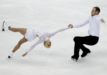 Yankowskas and Coughlin of the U.S. perform during the pairs free skating competition at the ISU World Figure Skating Championships in Moscow