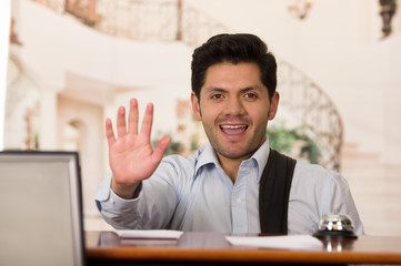 Happy smiling guest waiting the recepcionist, hotel background