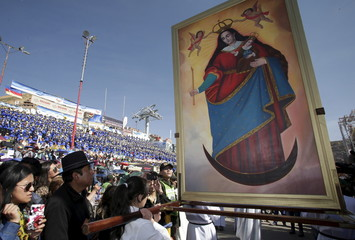 """A painting of the """"La Candelaria"""" virgin is carried in the annual brass band festival to kick off pre-Carnival festivities in Oruro"""