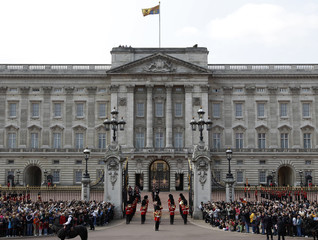 Tourists watch the Changing the Guard at Buckingham Palace in London