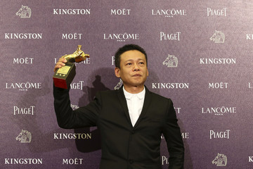 """Taiwanese actor Lee Kang-sheng celebrates winning the Best Leading Actor for """"Stray Dogs"""" at the 50th Golden Horse Film Awards in Taipei"""